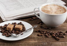 Cup of coffee and newspaper. Cup of coffee with sugar and newspaper royalty free stock photos