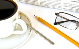 Cup of coffee and newspaper Stock Images