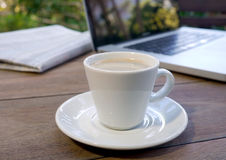 Cup of coffee with newspaper and computer Stock Photography