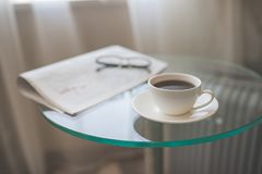 A cup of coffee with a newspaper Stock Photos