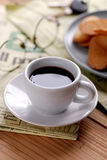 Cup of coffee and newspaper Stock Image