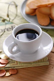 Cup of coffee and newspaper Royalty Free Stock Images