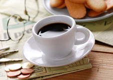 Cup of coffee and newspaper Stock Photography