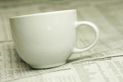 Cup of coffee and the newspaper Stock Images