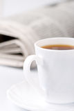 Cup of coffee and newspapers Stock Photography