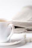 Cup of coffee and newspapers Royalty Free Stock Photo