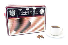 Cup of coffee next to the old radio and coffee beans isolated on white Stock Images