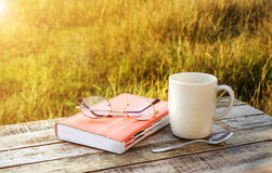Cup of coffee and note book on wooden table Stock Photo