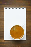 Cup of coffee and note pad, concept photo, top view Stock Photography