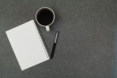 A cup of coffee with note and pen on working table with copy spa Stock Photo