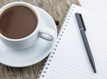 Cup of coffee, note Stock Images