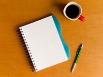 Cup of coffee and notebook Stock Photo