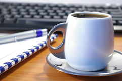 Cup of coffee and notebook Royalty Free Stock Photography