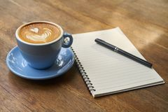 Cup of coffee and notebook royalty free stock image