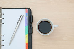 Cup of coffee and notebook Stock Image