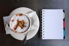 A cup of coffee and a notebook. On desk Royalty Free Stock Photo