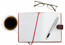 Cup of coffee notebook glasses. On white background stock photography