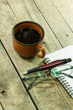 Cup of coffee with notebook Stock Photos