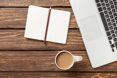 Cup of coffee and notebook with laptop computer Stock Photo