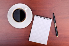 Cup of coffee, notebook and pen Royalty Free Stock Image