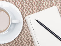 Cup of coffee and notebook Royalty Free Stock Images