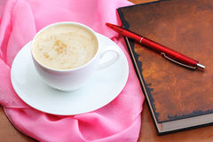 Cup of coffee with notebook and pen Stock Images