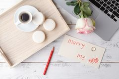 Cup of coffee, notebook and rose flowers. Vintage. Flat lay, top royalty free stock images