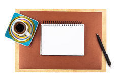 Cup of coffee and a notebook on textured paper Royalty Free Stock Photography