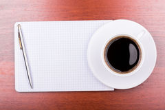 Cup of coffee on notepad Stock Photo