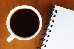 Cup of coffee with notepad Stock Photos