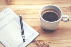 Cup of coffee. With notepad Royalty Free Stock Photo