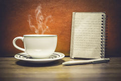 Cup of coffee with notepad for add you text Stock Images
