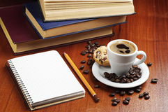 Cup of coffee, notepad and books Stock Photography