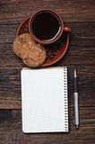 Cup of coffee and notepad Royalty Free Stock Images