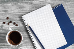 Cup of coffee and notepad Royalty Free Stock Photo