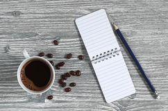 Cup of coffee and notepad Stock Image