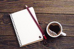 Cup of coffee and notepad Royalty Free Stock Photography