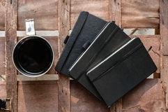 Cup of coffee with notepads Stock Images