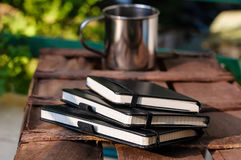 Cup of coffee with notepads Royalty Free Stock Images