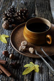 Cup of coffee, nuts and autumn leaves Stock Images