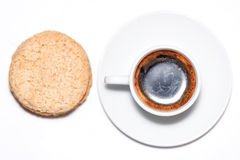 Cup of coffee and oat biscuits. Cup of coffee and oat cookies arranged on a white background Stock Images