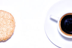 Cup of coffee and oat biscuits. Are located in different sides of the image Royalty Free Stock Image