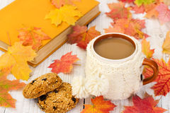 Cup of coffee and oatmeal cookies on background with autumn leav Stock Photography