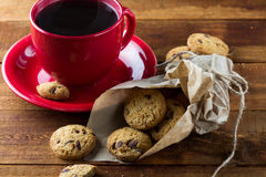 Cup of coffee and oatmeal cookies. background. Stock Photography