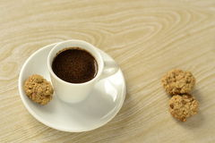 A cup of coffee and oatmeal cookies Stock Image