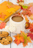 Cup of coffee and oatmeal cookies. On wooden background with autumn maple leaves Stock Photo