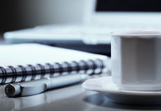 Cup of coffee  in office Stock Images