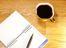 Cup of coffee and office notepad Royalty Free Stock Photos