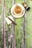Cup of coffee with office objects on wooden background Stock Image