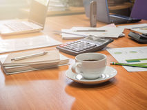 A cup of coffee and office supplies in meeting room Stock Image
